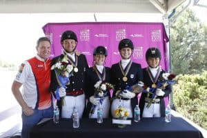 Allyn Mann of Adequan® with the gold medal-winning Region 1 team from the U.S., including Nicholas Hansen, Elizabeth Bortuzzo, Mallory Chambers and Lian Wolfe. (SusanJStickle.com)