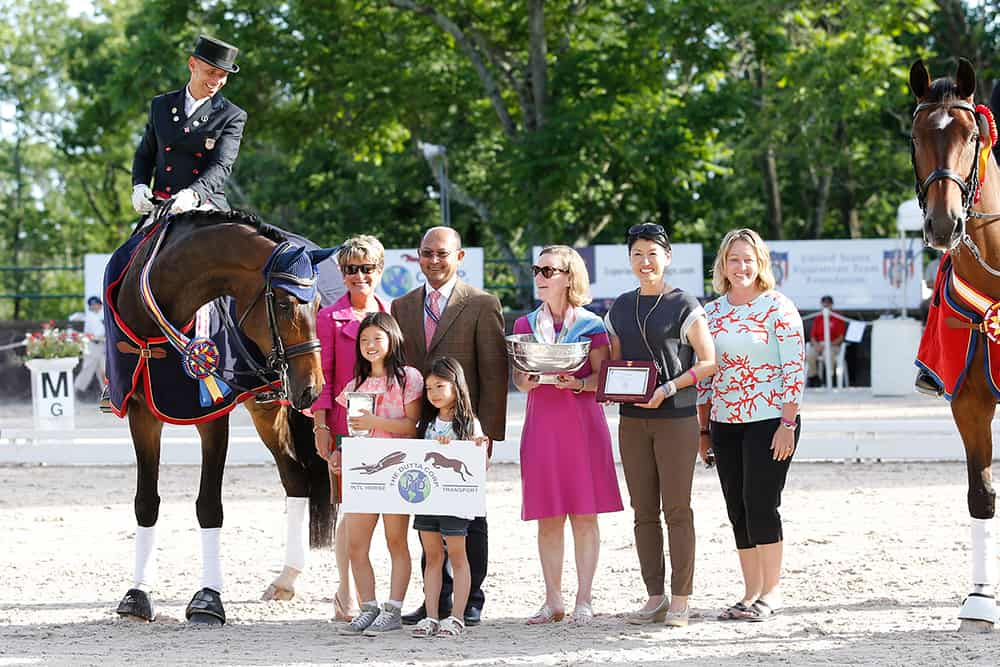 Steffen Peters and Legolas 92 won The Dutta Corporation/USEF Grand Prix National Championship in 2014. The pair is pictured with (left to right) Janet Foy, Tim Dutta, USET Foundation executive director Bonnie Jenkins, Akiko Yamazaki with daughters Miki and Emi Yang and Jenny Van Wieren-Page. (Photo: Susan J. Stickle)