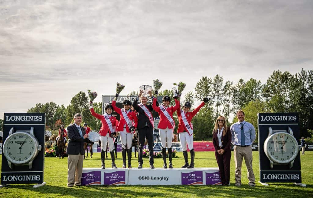 The Hermès U.S. Show Jumping Team stands atop the podium with Chef d'Equipe Robert Ridland to receive the top honors in the FEI Nations Cup™ CSIO4* Langley ©MOIPhotography / Aimee Wilson for Thunderbird Show Park
