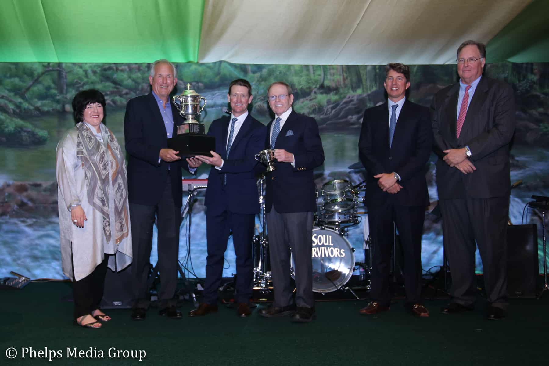Left to right: Betsy Juliano, Jim McNerney, McLain Ward, Brownlee O. Currey, Jr., Philip Richter and William Weeks present Ward with the 2018 Whitney Stone Cup.