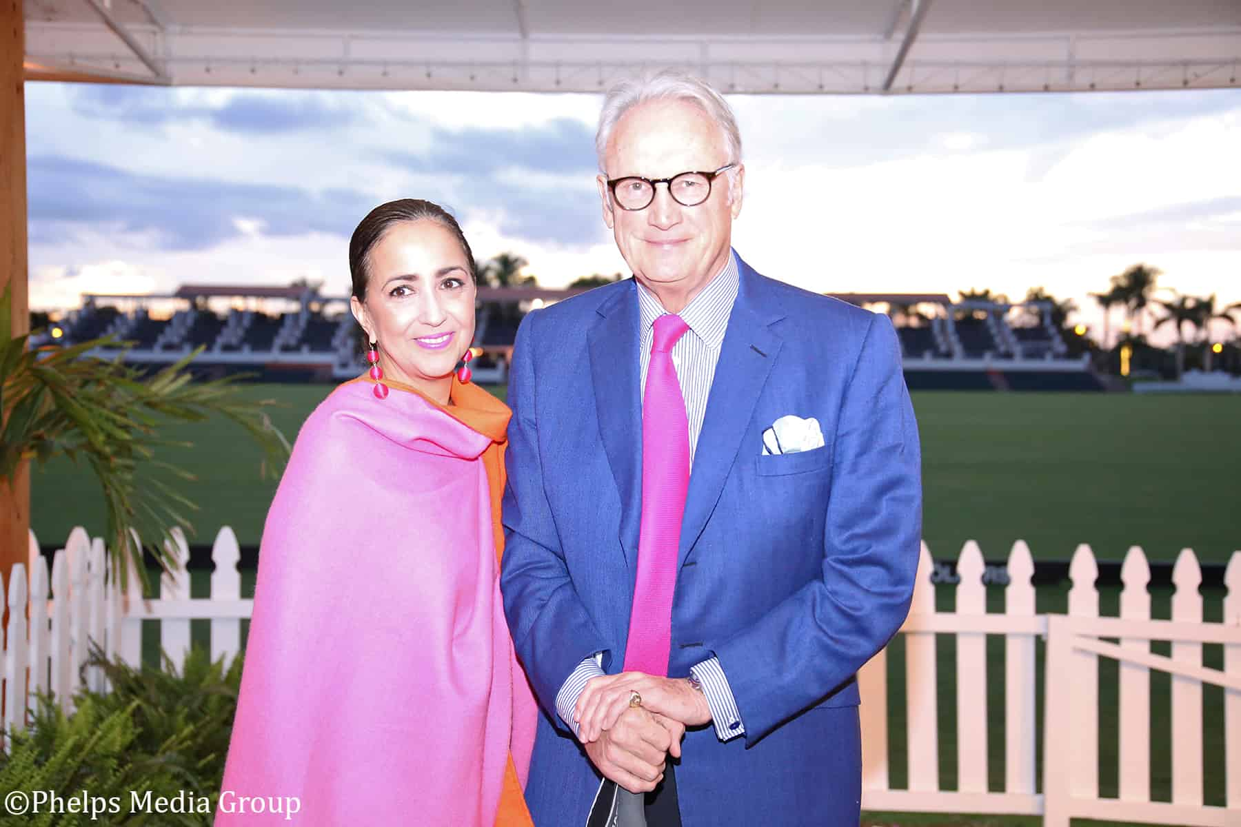 "Michael Taylor (right) of Taylor Harris Insurance Services (THIS) and Connie Marquez (left). THIS sponsored the cocktail hour at the International Polo Club prior to the start of the ""Triumph in Tryon"" gala."