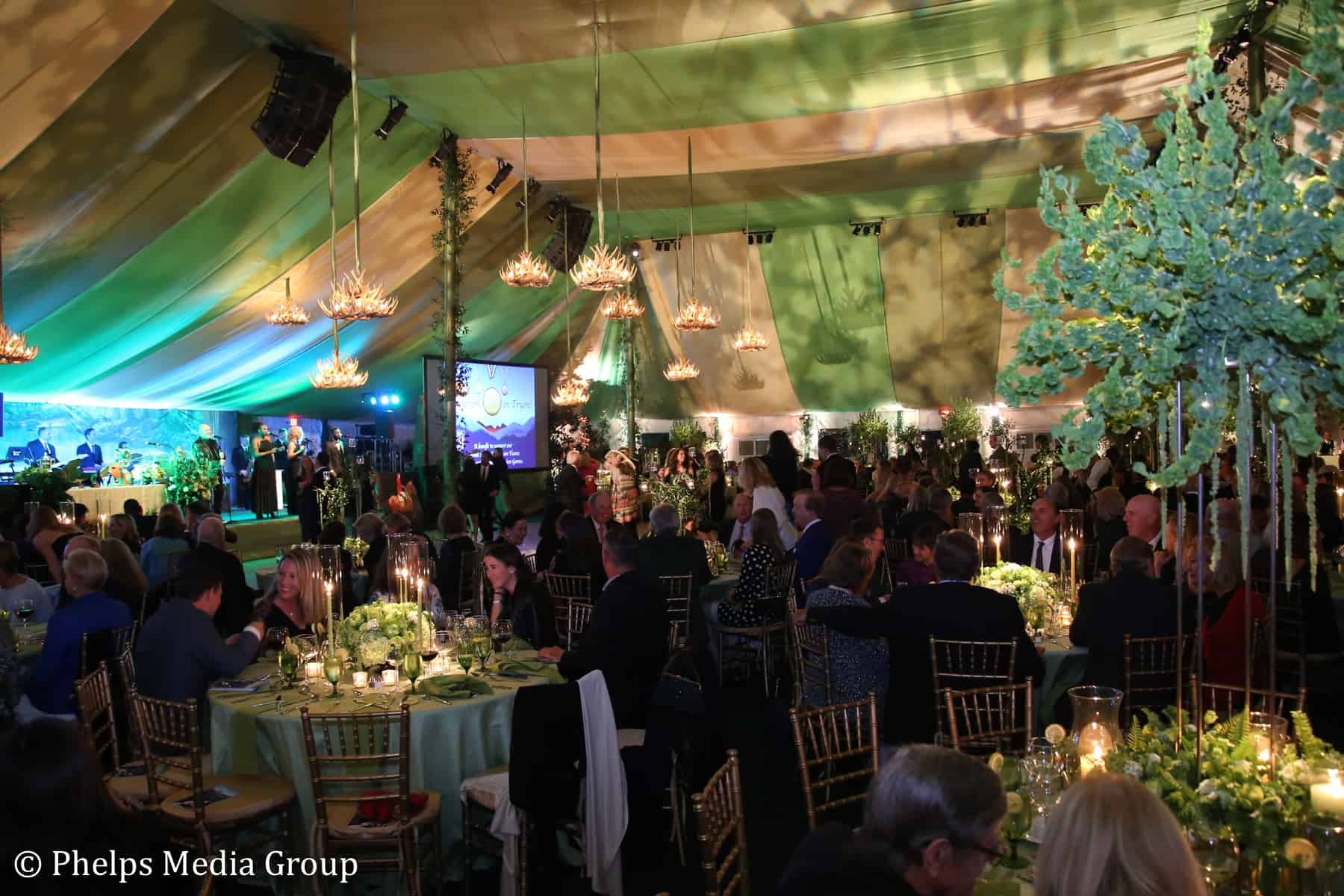 "Guests enjoyed dinner and dancing under the magnificently decorated tent at the ""Triumph in Tryon"" gala on Friday."