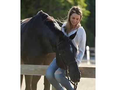 Madison Goetzmann petting horse